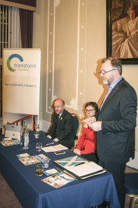 Ralph Roberts (McGill's Buses) introducing the event, with Patrick Harvie MSP and event chair Helen Todd